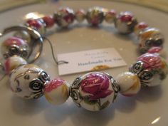 Handmade For You Hands-Free Beaded Bracelet KeyChain Keyring Pink Yellow and White Floral Ceramic, Silver Stretch Cord Fits Many Sizes K163 by JewelsHandmadeForYou on Etsy