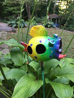 A personal favorite from my Etsy shop https://www.etsy.com/listing/455491688/birdfeeder-ceramic-funky-blowfish-bird