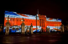 union jack projections projected onto Buckingham Palace