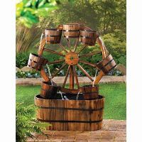 Wagon Wheel Outdoor Water Fountain Product Description: Add some country charm with this casual all wood wagon wheel outdoor water fountain! An old fashioned wagon wheel becomes a quaint backdrop for Wagon Wheel Garden, Garden Water Fountains, Fountain Garden, Outdoor Fountains, Water Garden, Barrel Fountain, Garden Pond, Fountain Design, Fountain Ideas