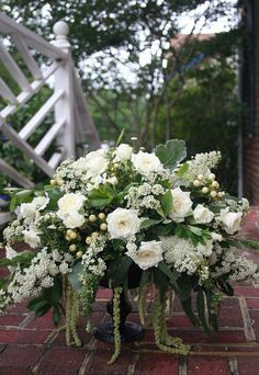 www.ishafossevents.com Spirea, spray roses, hypericum, dusty miller, and hanging amaranthus.
