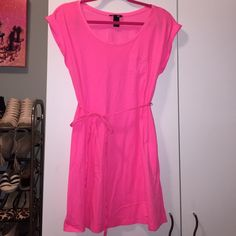 H&M - Neon Pink Tshirt Dress w Tie Belt Neon pink tshirt dress. Scoop neck, cuffed cap sleeves. Front pocket. Matching tie belt. Perfect condition! Small, but can likely fit a small or medium depending on how you'd like it to fit. H&M Dresses Mini