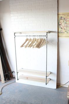 Industrial Clothing Rack / Closet Storage with 32 of hanger space and 3- 36 shelves. This piece has 6 mounting brackets which are spaced 32