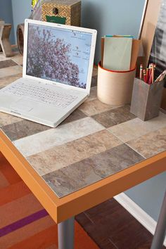 """Peel-and-stick vinyl floor tiles in various colors cut and used to """"tile"""" this desktop."""