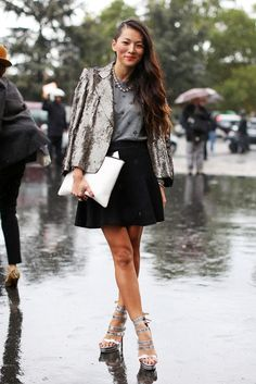 A metallic colored blazer adds texture to a black-white-grey outfit