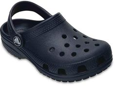 Your little one will love wearing these Crocs Kids' Classic Clogs that feature its signature ventilated holes. These lightweight slip-on shoes have a heel strap for a secure fit and are built with Croslite foam cushion. Black Casual Shoes, Black Slip On Shoes, Kids Clogs, Toddler Crocs, Crocs Crocband, Crocs Slippers, Crocs Classic, Childrens Shoes, Strap Heels