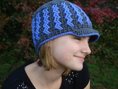 A super fun and somewhat challenging hat pattern! This one was really fun to design! Working with two colors and cables will give you a bit of a challenge to broaden your crochet horizons. This hat would look great in school colors!