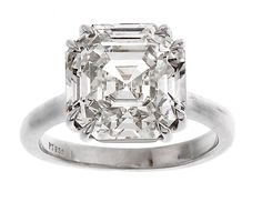 solitaire diamond engagement rings | platinum round diamond ring with pear shaped diamond sides $