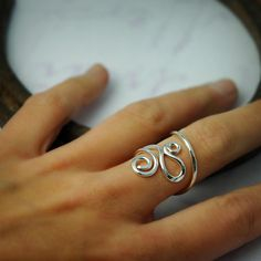 silver ring swirls & curves