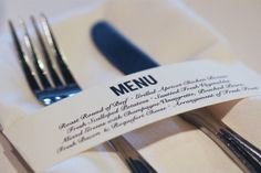 Print the menus on two inch bands of paper, wrapped them around the cloth napkins and secured them with a custom m + b sticker.