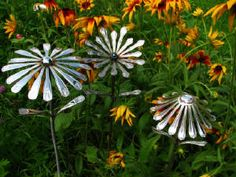 silverware flower stakes...amazing work w/ more samples at http://www.thesalvagegallery.com/