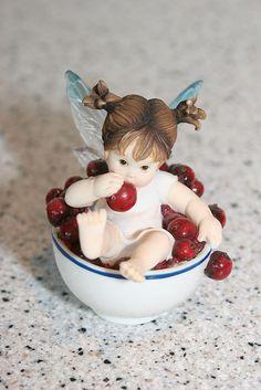 I took this of my little cherry kitchen fairy. Fairy Statues, Fairy Figurines, Cherries Jubilee, Cherry Kitchen, Azul Tiffany, Baby Fairy, Polymer Clay Miniatures, Sweet Cherries, Little Kitchen