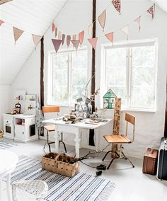 ... bright attic room with sweet pale colors and a lot of interesting elements.