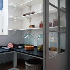 Before the refrigerator there was the larder; a cool space for storing perishables and kitchen essentials. Perhaps it's time to bring back the concept? Above: A larder tucked behind glass doors,.