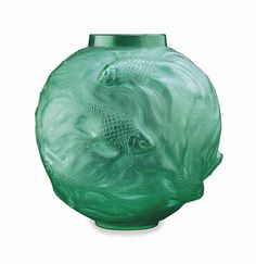 """French Formose molded green glass vase with fish by Rene Lalique, 20th century. H: 6 1/2"""" (16.5 cm). Etched signature: R. Lalique, France 