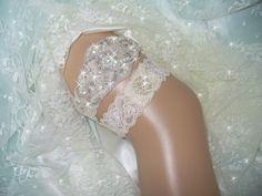 A personal favorite from my Etsy shop https://www.etsy.com/listing/222225706/custom-bling-wedding-garter-set-bridal