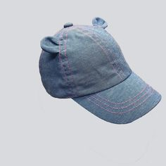 11255dfb83a This Baby Girls  Denim Baseball Hat with Ears from Cat and Jack in Blue 12
