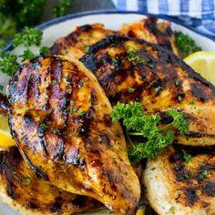 The best chicken marinade covering grilled chicken breasts, garnished with lemon. Best Chicken Marinade, Chicken Marinades, Grilled Chicken Recipes, Marinated Chicken, Grilling Recipes, Cooking Recipes, Healthy Recipes, Oven Recipes, Meal Recipes