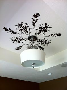 Stencil or use vinyl wall decals on the ceiling above a light fixture to dress the room up and give the ceiling visual interest. Deco Luminaire, Plafond Design, Home And Deco, Vinyl Wall Decals, Wall Stickers, Vinyl Art, Kitchen Wall Decals, Wall Decals For Bedroom, Window Decals