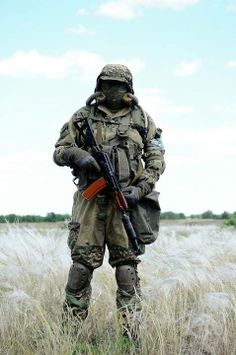 Russian Spetsnaz member in Mission Oriented Protective Posture (MOPP) gear with suppressed AKS-74U assault rifle