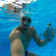 Olympian swimmer and Waiakea ohana @eza_surf trains with Waiakea Hawaiian Volcanic water. And apparently drinks it underwater as well  || #waiakeaohana #olympics #swim #drinkhealthy