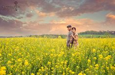 Connection Photography, beautiful skies, fields with flowers and great couple poses.