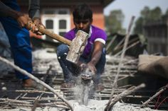 HOLDING STEADY: Nepalese construction workers demolished a roadside building as part of a road expansion process in Katmandu, Nepal, Tuesday. (Narendra Shrestha/European Pressphoto Agency)