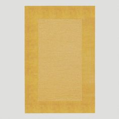 One of my favorite discoveries at WorldMarket.com: Gold Bordered Tufted Wool Rug $250 -- more of a tan than yellow