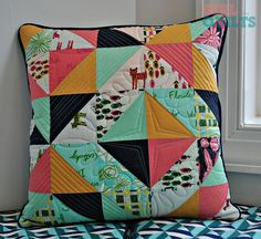 """Love the color/print combo and different quilting elements.  Well done!  https://flic.kr/p/rTV22W 