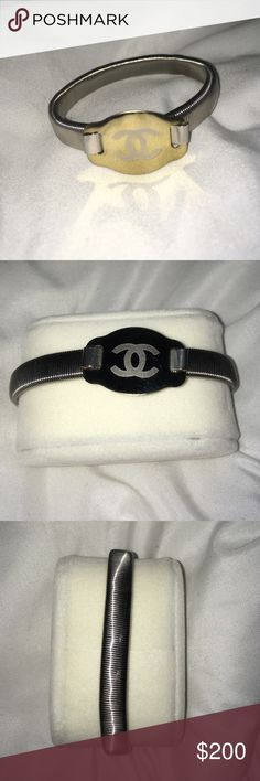 Chanel bracelet UNISEX-has a couples of little scratches but not noticeable unless your super close! Super cute. It has an adjustable band. Stainless steel. This will not get ugly or green. CC is gold. We are unsure if it authentic as we found it in a car we purchased a while ago and we now found it 8 months later while detailing it. No trades. 😊😊 CHANEL Jewelry Bracelets