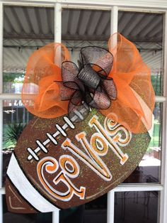 Door Hanger: Wooden Football Door Decoration, Custom Football. $35.00, via Etsy.