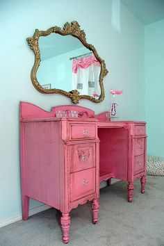 ah! brilliant! old desk + hanging mirror = vanity! probably of small bathroom counter solved. (the pink is a bit much though.)