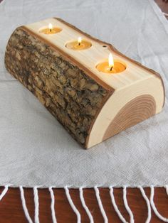 Candle Holder - split log reversible bark on wood candle holder with pure beeswax candles.via Etsy. Wooden Projects, Wooden Crafts, Log Projects, Log Candle Holders, Selling Handmade Items, Log Furniture, System Furniture, Beeswax Candles, Diy Holz