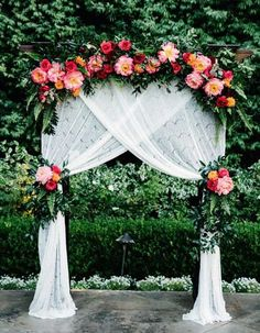 12 Peony-Inspired Wedding Ideas For The Prettiest Day Ever - Wilkie Blog! - Peony accented arbor with greenery