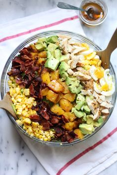Harvest Cobb Salad with Maple Vinegarette: About 10 cups of lettuce/greens (your choice, I used romaine) 1 small acorn squash 1 ear of corn 10 strips (or so) or bacon 3 eggs 2 boneless, skinless, chicken breasts 1 avocado 3 tablespoons maple syrup 3 tablespoons apple cider vinegar 3 tablespoons extra virgin olive oil Salt & Pepper to Taste