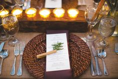A simple clothespin and a branch of Rosemary give place settings a colorful and an herbal accent.  Photo by Kent Bristol Photography