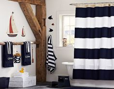 This nautical room designed by Pottery Barn Kids looks super pulled-together, but you can re-create the same look without blowing your budget. The key is matching in the coordinating bath linens — easy enough for us!