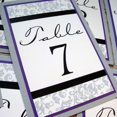 Wedding Table Numbers in Purple and Grey Damask with Swarovski Crystal - Set of 12. $30.00, via Etsy. - these are gorgeous and would be $60 for all the tables you need maximum.