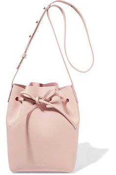 Mansur Gavriel's bags are loved for their minimal branding and uncomplicated design. This mini bucket style has been expertly made in Italy from cream leather. The streamlined interior will comfortably house your wallet, cell phone and a small cosmetics case.