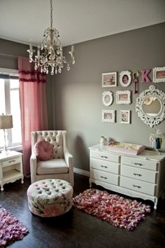 great light and color contrast Grey with Pink and white furniture against dark wood floors