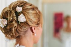 the bride wore roses in her hair...