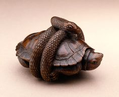 Snake Encircling Turtle, early 19th century Netsuke, Wood with inlays | LACMA Collections