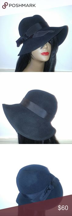 """Vintage Black Felt Chic Hat With Ribbon Band Vintage Black Felt Chic Hat With Ribbon Band This Hat has Attitude ! Rich Black Color. Uneven Brim Makes this a Stunner ! Antelope Felt made in England for Saks Fifth Ave. Grosgrain Ribbon Band. Measures: 22"""" A Winner !! Vintage Accessories Hats"""