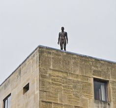 """""""Suicide"""" statues by Antony Gormley.    http://www.salon.com/2012/05/11/suicide_statues_atop_brazil_roofs_give_fright/"""