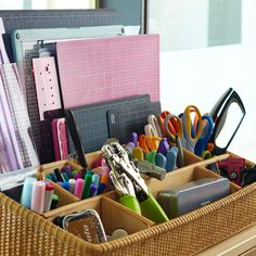 A large desk organizer can fit smaller cutting mats and acrylic rulers and templates. Smaller items, such as scissors, marking tools, and embellishments can fit in the separaters.