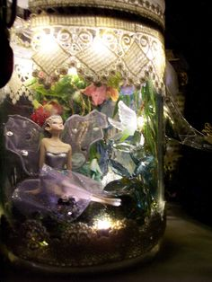 Put the Glue Down: Captured Fairy in a Jar with Resin Waterfall and Nightlights .....Hope to attempt in 'altering' a jar sometime soon.