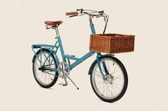 amazing blue bike with high seat, and wooden basket low on front. low ridin'.
