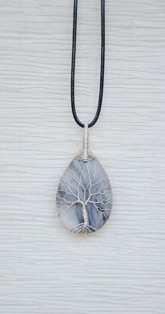 Hey, I found this really awesome Etsy listing at https://www.etsy.com/listing/223424612/tree-of-life-copper-wire-wrapped-grey