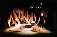 The play is set in the 1600s. Buildings in New England at this time were predominantly wooden. What we see is either the result of an explosion, or something in an early stage of construction. Either way, there are a lot of pieces. What we make of them remains to be seen.