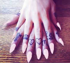 finger tattoos~ like the placement not the signs...